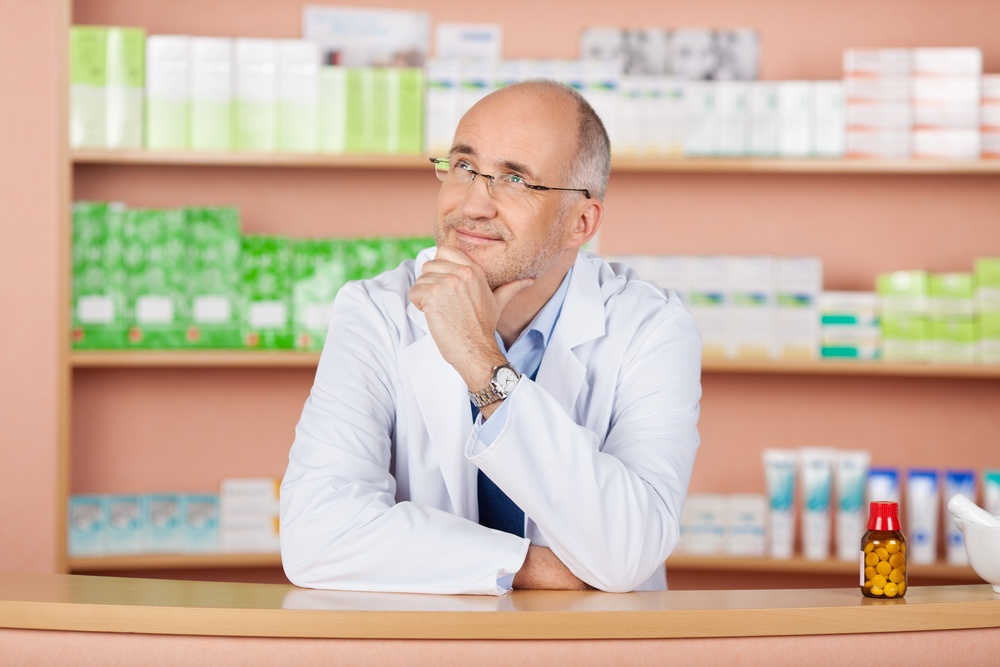 Close up portrait of looking up pharmacist standing in pharmacy drugstore.jpeg